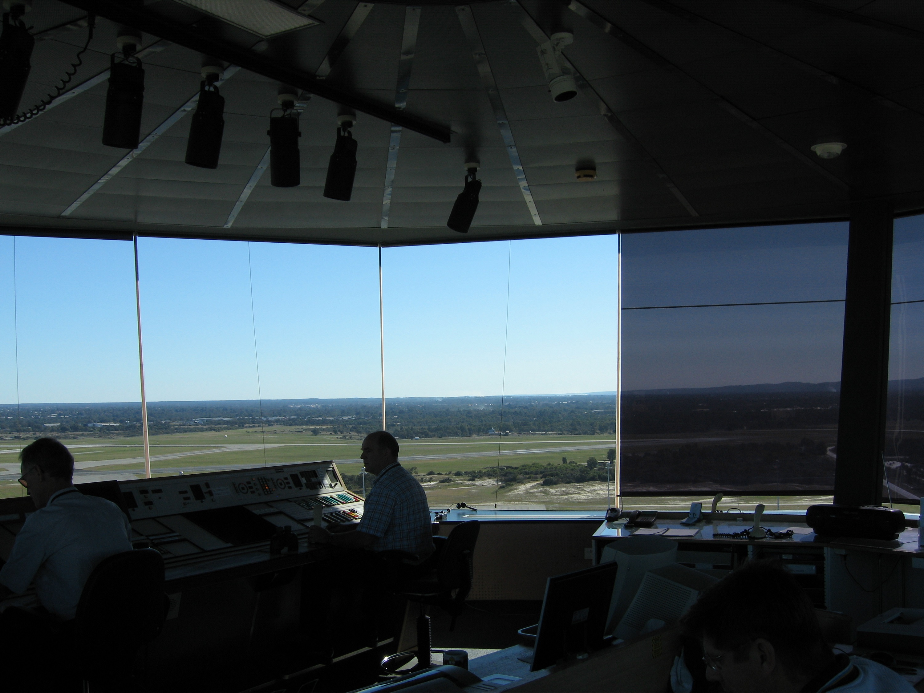A airport tower window with a Reflective Blind solar heat & glare reducing roller blind installed.