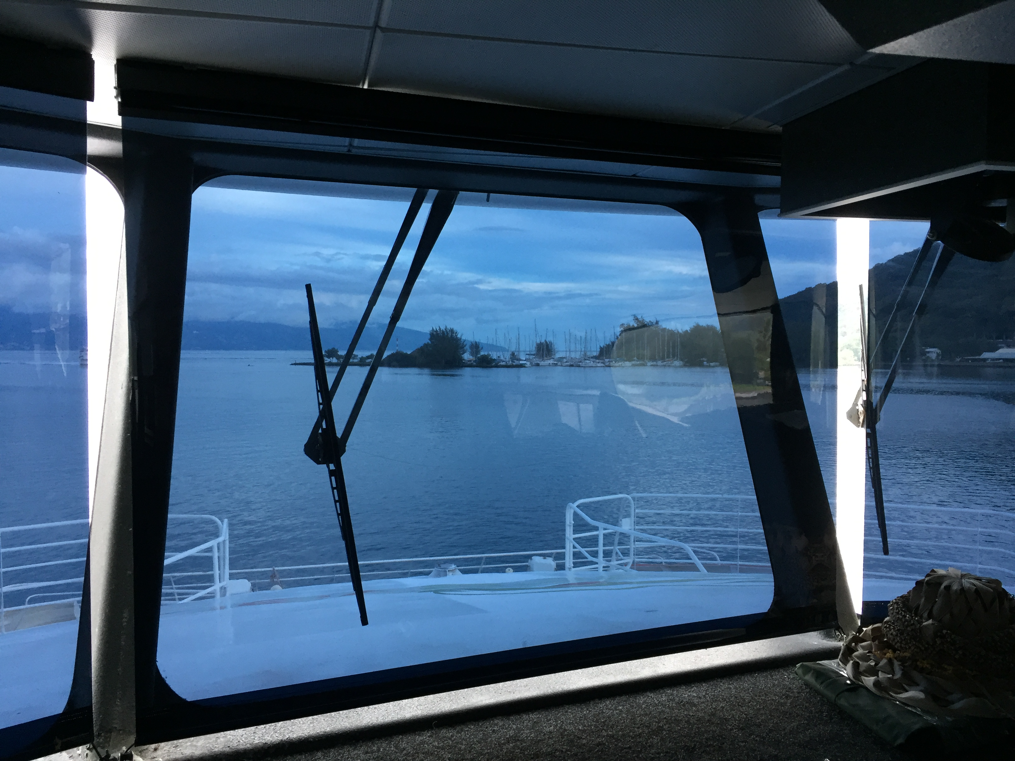 A boat window with a Reflective Blind solar heat & glare reducing ship roller blind installed.