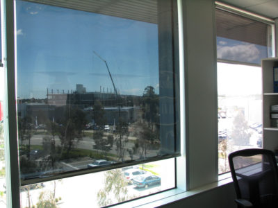 Commercial & Office Blinds: A window with a Reflective Blind solar heat & glare reducing roller blind installed.